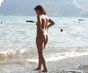 A bikini cutie going topless on the Biarritz