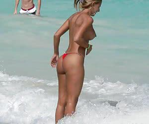 A busty bikini slut undressing on the Cap d'Agde