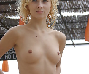 A nude posing at the Costa Natura
