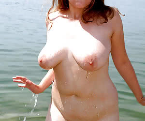 Busty mature ladies in a water under the sun