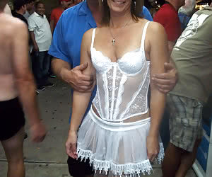 Mature women having sexy fun at a night carnival