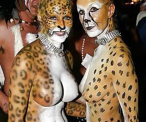 Night bodypainting party with nude mature and young women