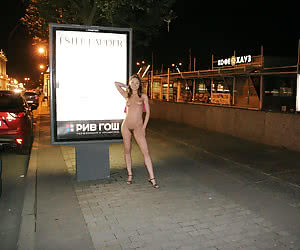 Young amateurs trying a night public nudity in the city