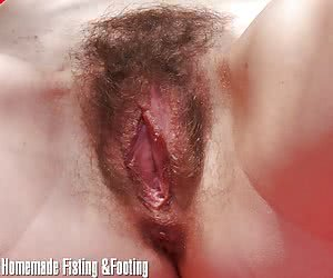 Horny bitch with hairy cunt takes dildo inside