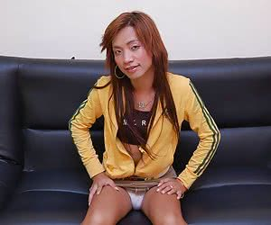 Pretty asian ladyboy takes off her lingerie on the black coach