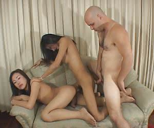 Two sweet ladyboys in real orgy with straight guy