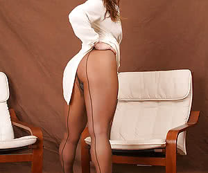 Sultry woman with strong legs in pantyhose