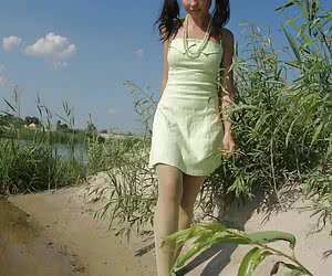Pigtailed teenager showing every inch of her hot young body at the lake side