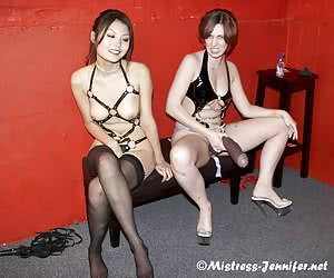 Two Mistresses play with a huge strapon and penetrate male slave