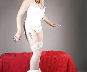Starting in my lovely white skirt and basque with accompanying hold-ups and knickers, I begin a slow strip until I am le