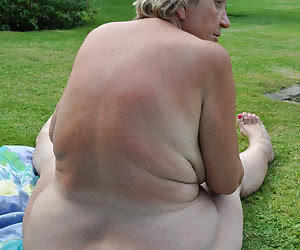 Fat nudist dames of 40-60 y.o. showing their asses