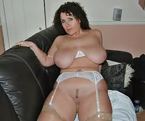 Chubby slut posing on her bed collection