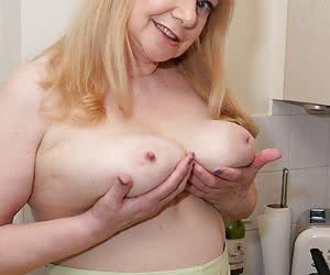 Im soon sat up on the counter fingering my pussy and rubbing my clit and feeling extremely Hot and Horny so I grab my Wh