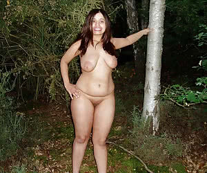 Naturists near the trees in a deepth of the night