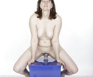 In the photo studio a horny ride on a dildo.Deeply penetrates the thick transparent dildo.And it expands enormously my l