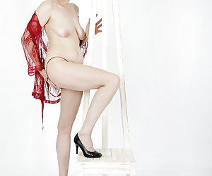 In the red Negligee.Makes my curves beautiful or not.Good nude is nicer.And I like being naked.