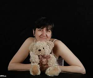 Posing with a Teddy bear.Desire pictures of a dear friend.Playful pictures.