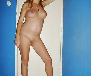 Amanda, young preggie housewife posing full nude and with spread leggs.
