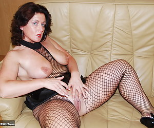 Manuela, horny mature milf wearing high heel shoes and a crotchless fishnet body-stocking. Manuela spreads her legs wide