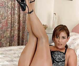 MILF in shiny seamless pantyhose and high heels on the bed