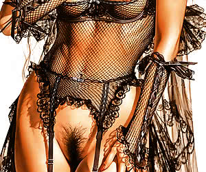 Seductive pinup lady in very erotic black lace lingerie
