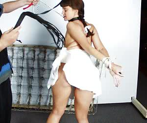 Tied young brunette flogged and spanked hard