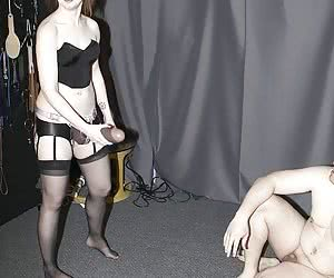 Amateur Mistress makes male slave to suck a huge black strap-on cock and penetrates him