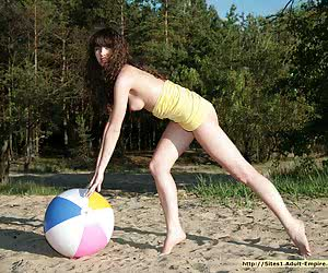 Cute eighteen years old girlie getting naked and completely nasty on a wild beach