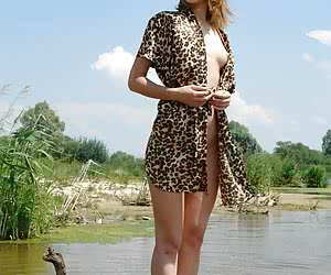 East-European hottie undressing and having nude fun on a river coast
