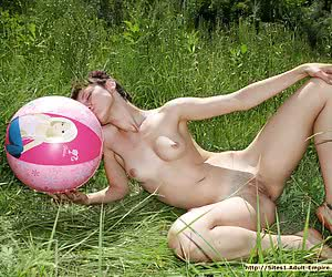 Skinny eighteen years old girlie playing with a ball without any clothes on