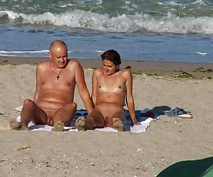 Voyeur pictures of a middle aged couple of suntanned nudists