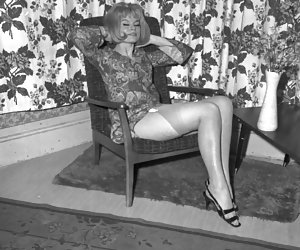 First of all, hothead blonde poses in dress and stockings then remains in white vintage lingerie