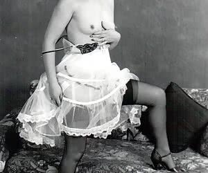 Gorgeous gals in sexiest vintage lingerie have real fun while posing and showing tits on camera